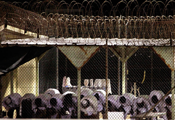 Muslim terrorist prisoners praying for jihad