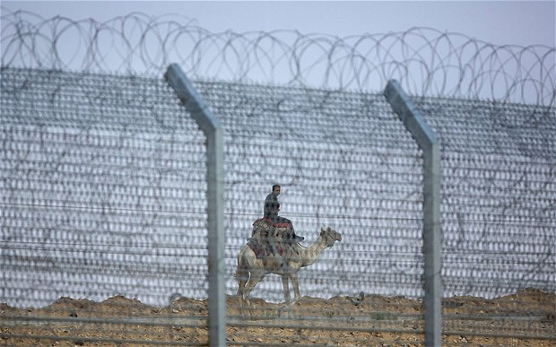 Egyptian soldier standing guard at the Sinai border