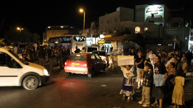 Jewish residents of Ras al-Amoud call for better police protection during a demonstration