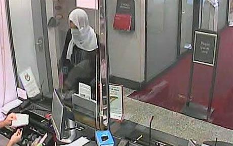 An actual photo of a man dressed as a Muslim woman just before he holds up a bank