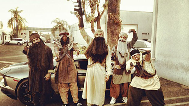 How appropriate! Singer and notorious woman-beater Chris Brown and pals dress up as Islamic terrorists for Halloween