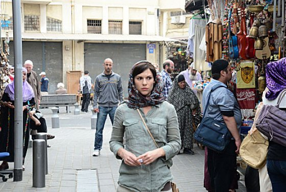 Carrie in her dark hair and hijab in Beirut
