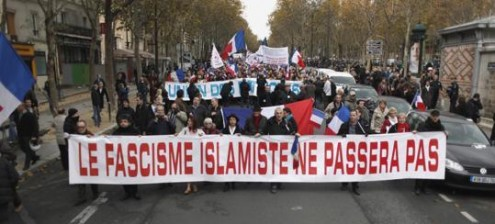 French patriots in Paris come out to protest against Islamization of their country, chanting the French anthem and saying that Islam has no place in the country