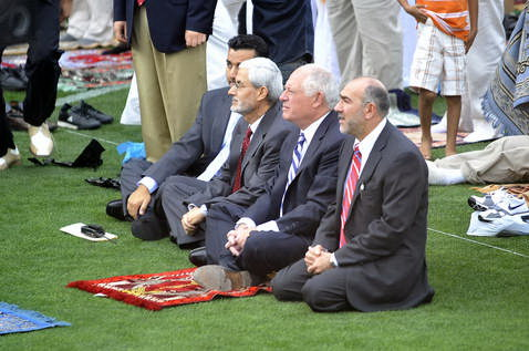 'Dhimmi' Governor Pat Quinn joins in prayer with Chicago area Muslims during Salaat al-Eid at Toyota Park, which celebrates the end of Ramadan.