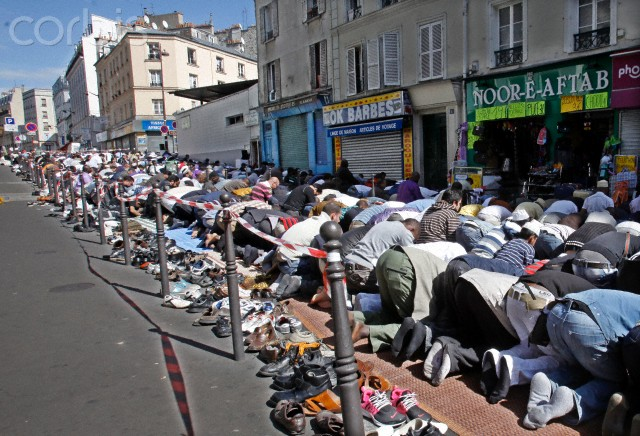 Muslims pray in the streets of Paris for the end of Ramadan.