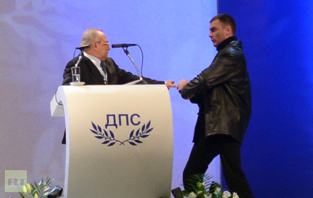 Unidentified man (R) attacks Ahmed Dogan