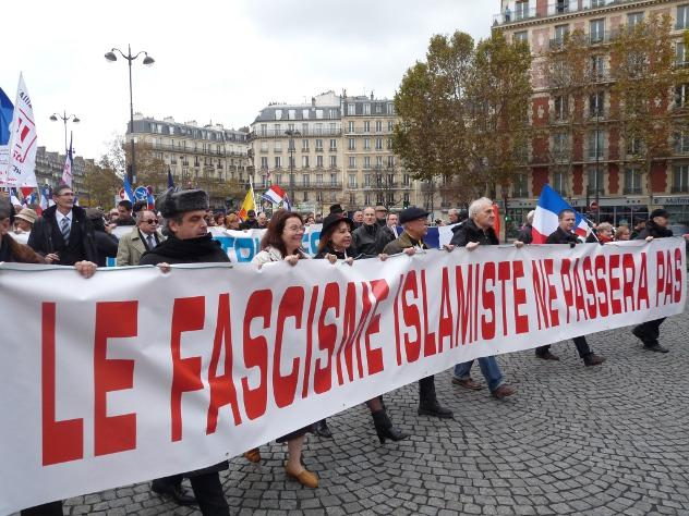 Hundreds of French patriots in Paris come out to protest against Islamization of their country, chanting the French anthem and saying that Islam has no place in the country.