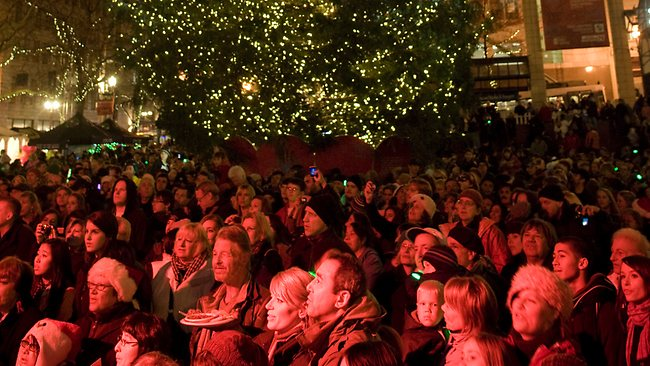 A CROWD WATCHES AS A CHRISTMAS TREE IS LIT ON PIONEER COURTHOUSE SQUARE IN PORTLAND, OREGON, WHERE FEDERAL AGENTS IN A STING OPERATION ARRESTED SOMALI-BORN MOHAMED OSMAN MOHAMUD JUST AS HE TRIED BLOWING UP A VAN FULL OF WHAT HE BELIEVED WERE EXPLOSIVES AT THE CROWDED CEREMONY.