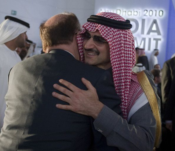 Rupert Murdoch, CEO of News Corporation, embracing Prince Alwaleed bin Talal, a nephew of Saudi King Abdullah and the world's 22nd richest person.