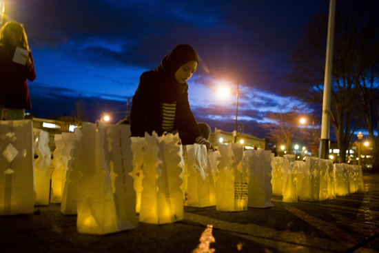 "Sana Hashimani (ENG'15) arranges lit-up paper bags to read ""Coexist"" during Light the Night."