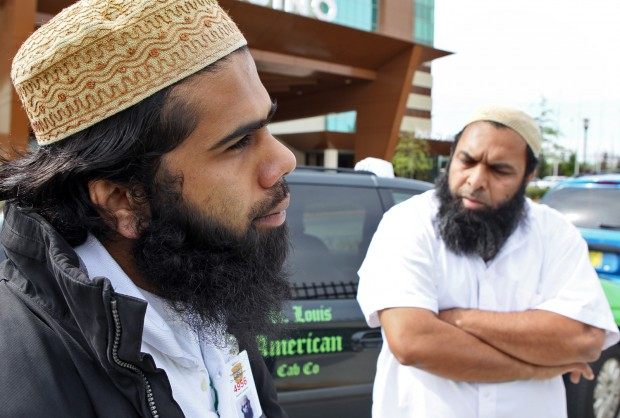 St. Louis Taxi drivers Nabeel Langrial, 23, left, and Raja Naeem, 46, talk on April 20, 2011, about the problems they've had with the taxi commission.