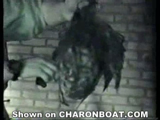 charonboat_dot_com_female_beheading_by_chechen