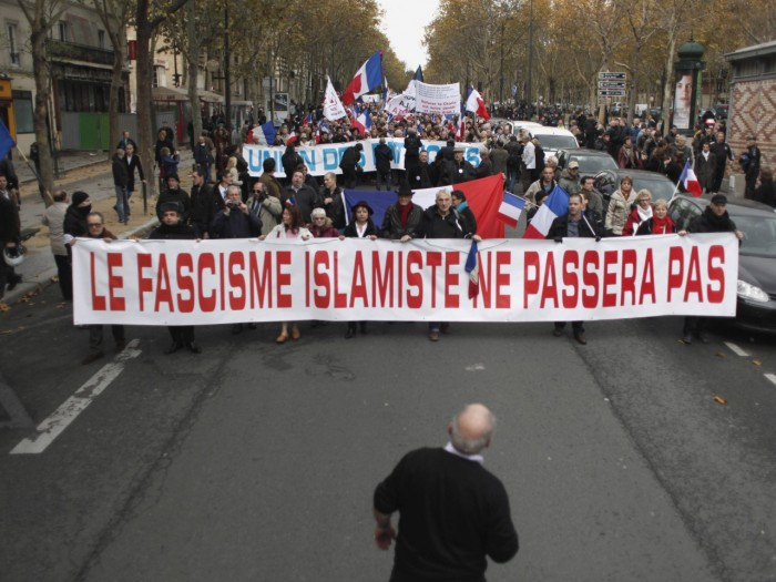 """People hold a banner reading: 'islamic fascism shall not pass"""" during a demonstration in Paris, Saturday Nov.10, 2012. France is home to Western Europe's largest population of Muslims, estimated to be at least 5 million"""