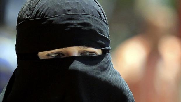 An Egyptian woman wearing nijab walks in Cairo