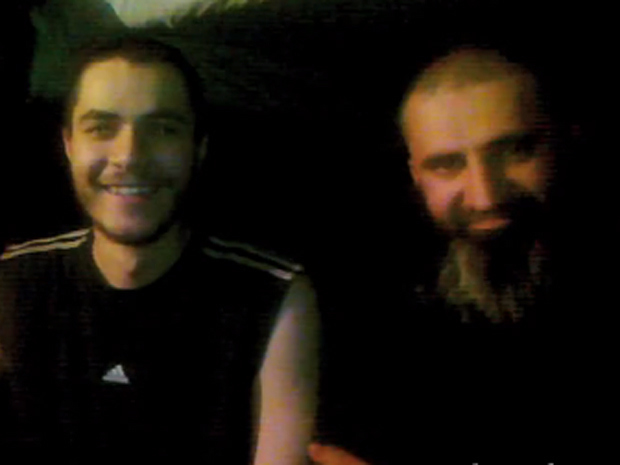"William Plotnikov (L), seen with an unidentified jihadist: ""Allah is with us, we have our guardian, Allah, but you do not have one. We will kill you."""