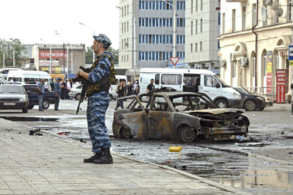 A policeman keeps watch at the site of a suicide bombing in Grozny, the capital of Chechnya