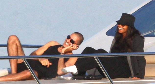 On the boat, Wissam looks cool but Janet must be sweating in her black garbage bag