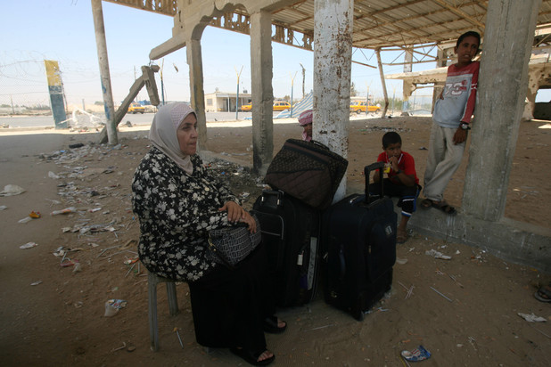 A Palestinian woman wates at the Rafah crossing with Egypt