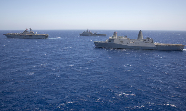 USS Kearsarge (LHD-3), left, leads the amphibious dock landing ship USS Carter Hall (LSD-50) and the amphibious transport dock ship USS San Antonio (LPD-17) on June 16, 2013.