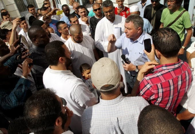 Mayor Edouard Jacque address the angry mob of muslims outside