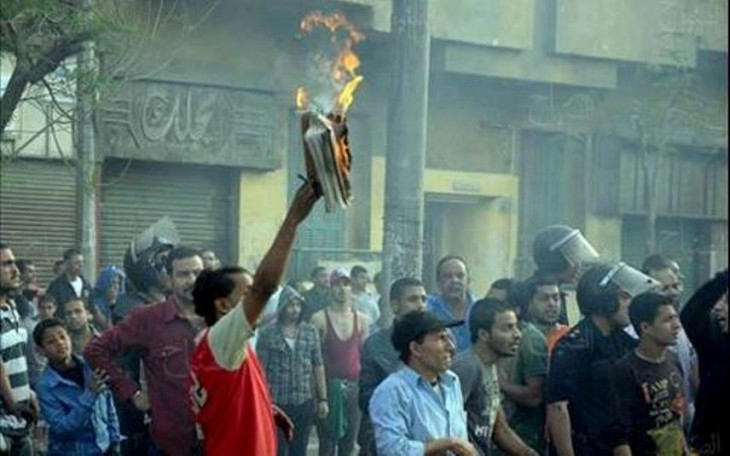 A Muslim burns a Bible in front of the cathedral