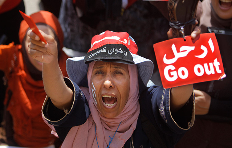 An Egyptian protester shouts slogans in Tahrir Square