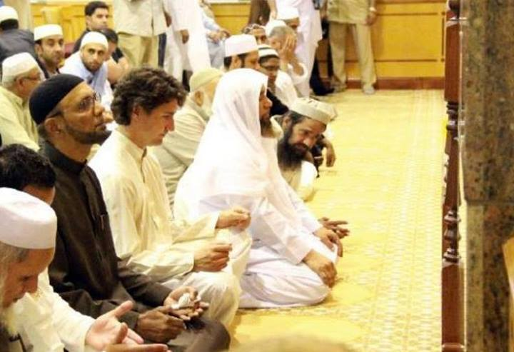 Trudeau (uncovered head) seen praying a mosque. Has he converted?