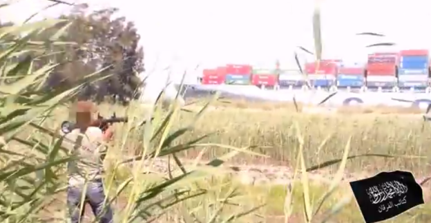 Image captured from a Sept. 4 video alleged to show memebers of the group Al-Furqan firing a rocket propelled grenade at a merchant ship in the Suez Canal