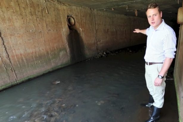 Sunday Mirror reporter Russell Myers is pictured inside the tunnel