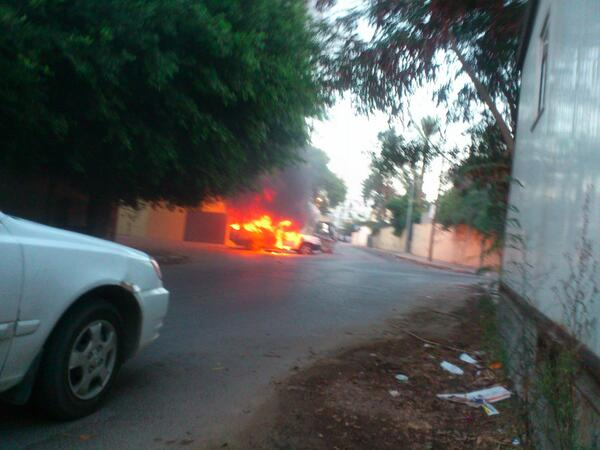 Car on fire outside Russian Embassy in Tripoli. Claims that 2 grenades were thrown from inside the embassy