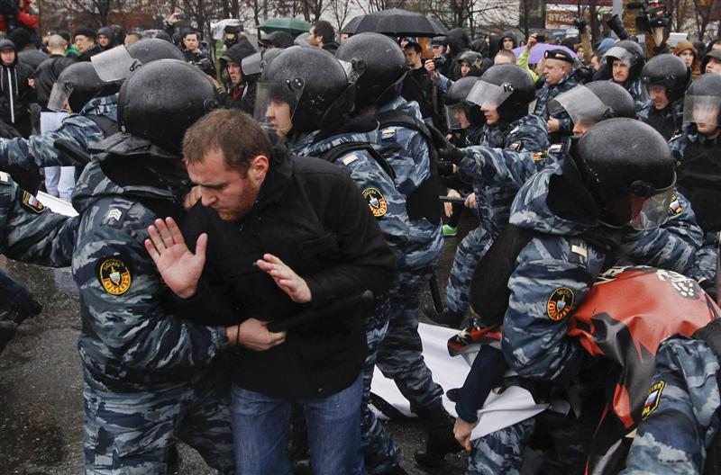 """Riot police block participants during a """"Russian March"""" demonstration on National Unity Day in Moscow"""