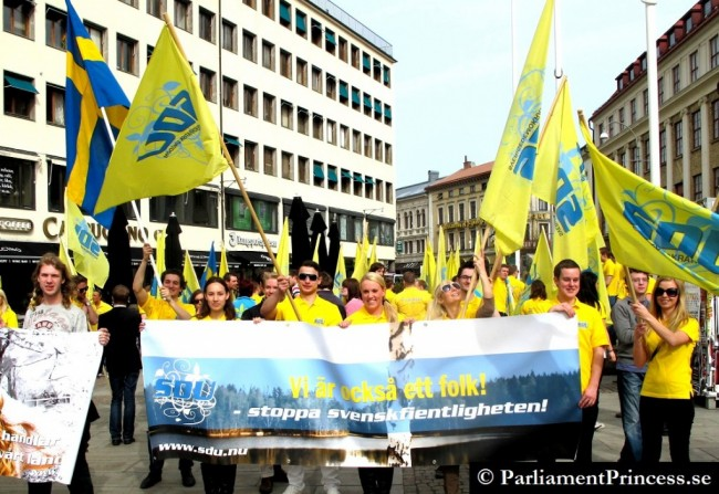 """SWEDEN Democrats (Youth Div) carry signs that say: """"We are also a people. Stop hostility towards Swedes."""""""