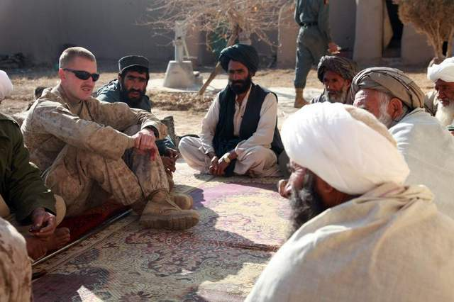 Then-Capt. Jason Brezler meets with leaders in Now Zad, Afghanistan