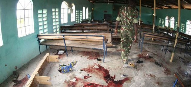 A Kenyan policeman at the site of a gun and grenade attack on a church, Garissa, northern Kenya, July 2012. 17 were killed in what is believed to be a reprisal for operations against al Qaeda-linked insurgents in Somalia.