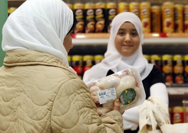 Moroccan women buy halal food in a Coop supermarket chain in Rome
