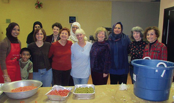 Muslims and Jews prepare to make meals for the hungry and homeless during the Weekend of Twinning, Nov. 10, at a Rockaway mosque.