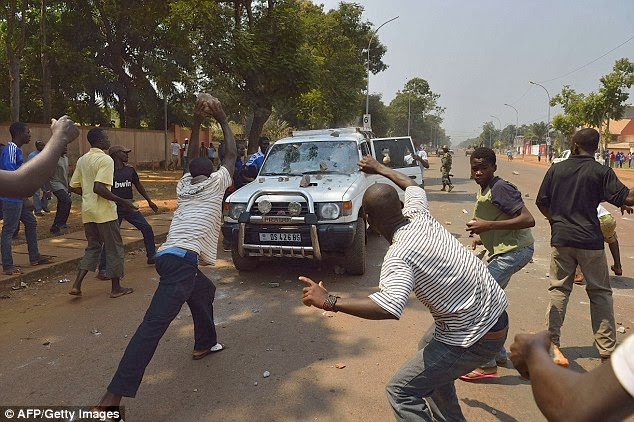 People throw stones at a car transporting two children of an ex-Seleka colonel at the 'UN crossroad'