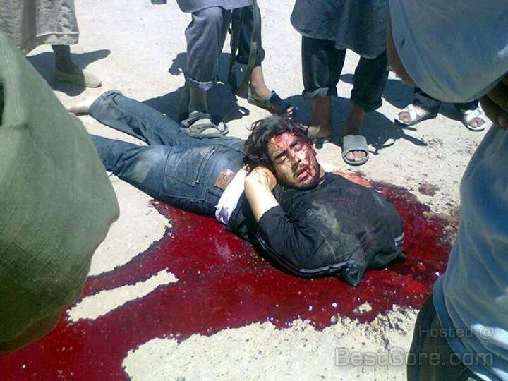 man-kidnaping-beheading-jabhat-al-nusra-family-show-photo-syria