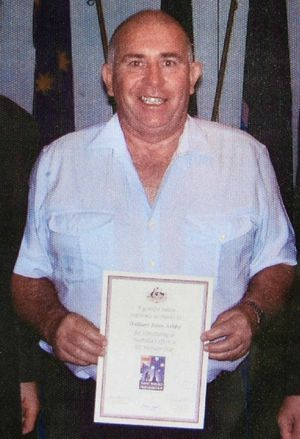 Neville Irwin receives his Vietnam service appreciation certificate.