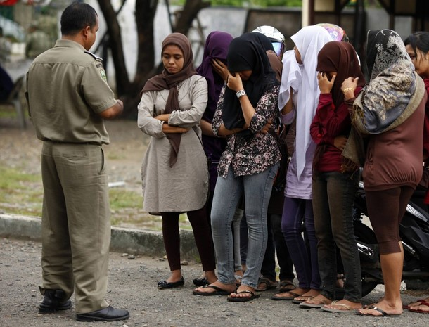 Sharia police warn young women of the consequences of not adhering to Islamic dress codes