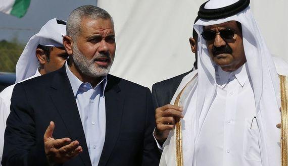 Hamas Prime Minister Ismail Haniyeh (L) and the Emir of Qatar Sheikh Hamad bin Khalifa al-Thani
