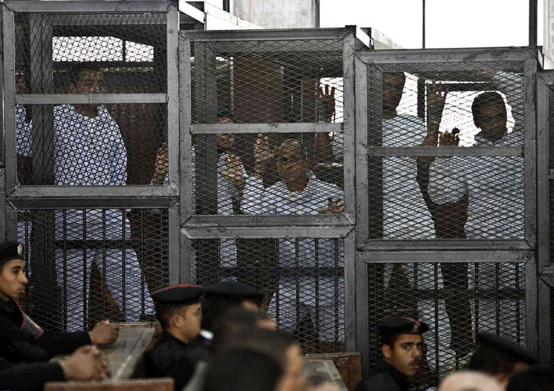 Muslim Brotherhood savages in their cages during the trial