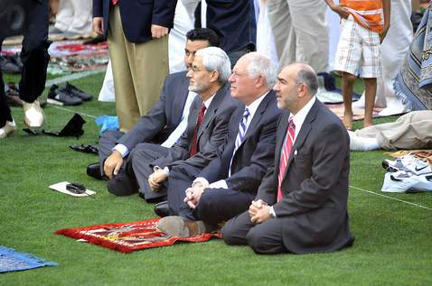 Gov. Pat Quinn with his own little prayer rug as he joins in prayer with Chicago area Muslims during Salaat al-Eid at Toyota Park, which celebrates the end of Ramadan
