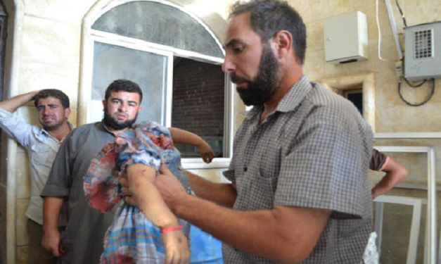 A father holds up the body of his daughter, beheaded by jihadist rebels