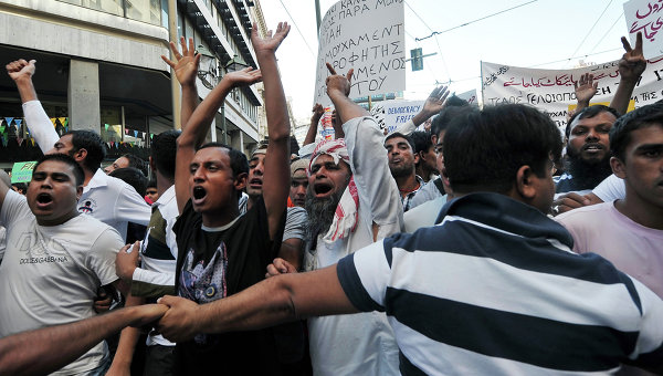 Muslim illegals protesting the police in Athens