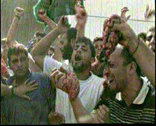Palestinian Arabs show off eating of the internal organs of IDS soldiers
