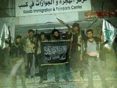Turkey-sponsored jihadis pose with Islamic flag in conquered Christian Armenian town of Kessab.