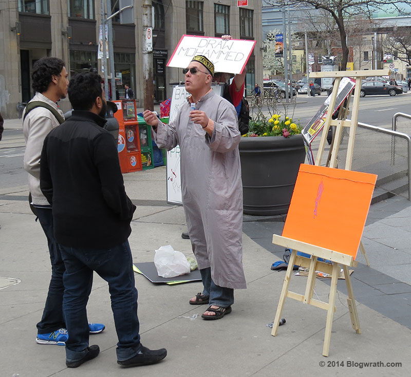 Eric Brazau talks with Muslims in front of the easel