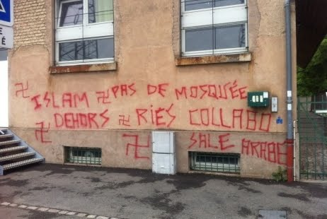 An application has been made to turn this prayer room in Strasbourg into a mosque. The local people have used graffiti art to express their feelings on the matter. Their messages include: 'Islam Out,' 'Dirty Arabs,' 'No Mosque' and 'Islam: Ries Collaborator' (Ries is the Mayor of Strasbourg).