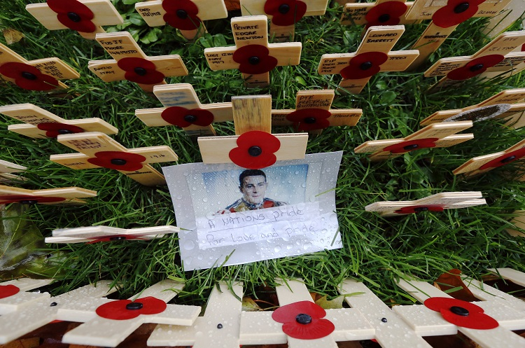 A photograph of Drummer (Private) Lee Rigby of the Royal Regiment of Fusiliers is pictured in the Field of Remembrance at Westminster Abbey in London